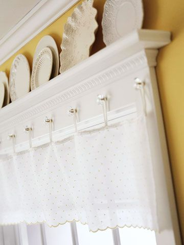 Cabinet hardware, like glass drawer pulls, makes attractive drapery hardware as well. These vintage crystal knobs offer a place to hook thin loops from the top of a sheer fabric valance.