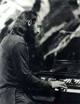 Mike Pinder plays his Mellotron, an electro-mechanical, polyphonic tape replay keyboard originally developed and built in Birmingham, England, in 1963.
