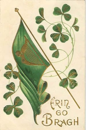 """Antique St. Patrick's Day """"Erin Go Bragh"""" postcard. The card features the harp flag, shamrocks, and the Irish phrase used to express allegiance to Ireland, most often translated as """"Ireland Forever."""""""
