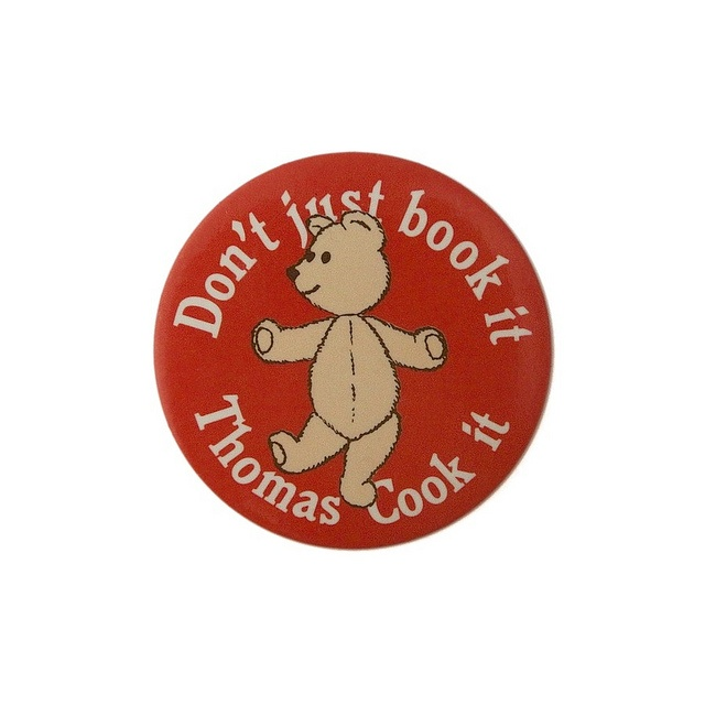 1980's Promotional Badge - Thomas Cook (British travel agency), featuring their famous advertising slogan: 'Don't just book it ... Thomas Cook it' which was used between 1984 - 1993. The early TV ads featured a little girl and her teddy bear 'Oliver'