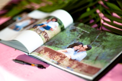 make a photo book of photos through the years and have guests sign on a page showing the age you were when you met