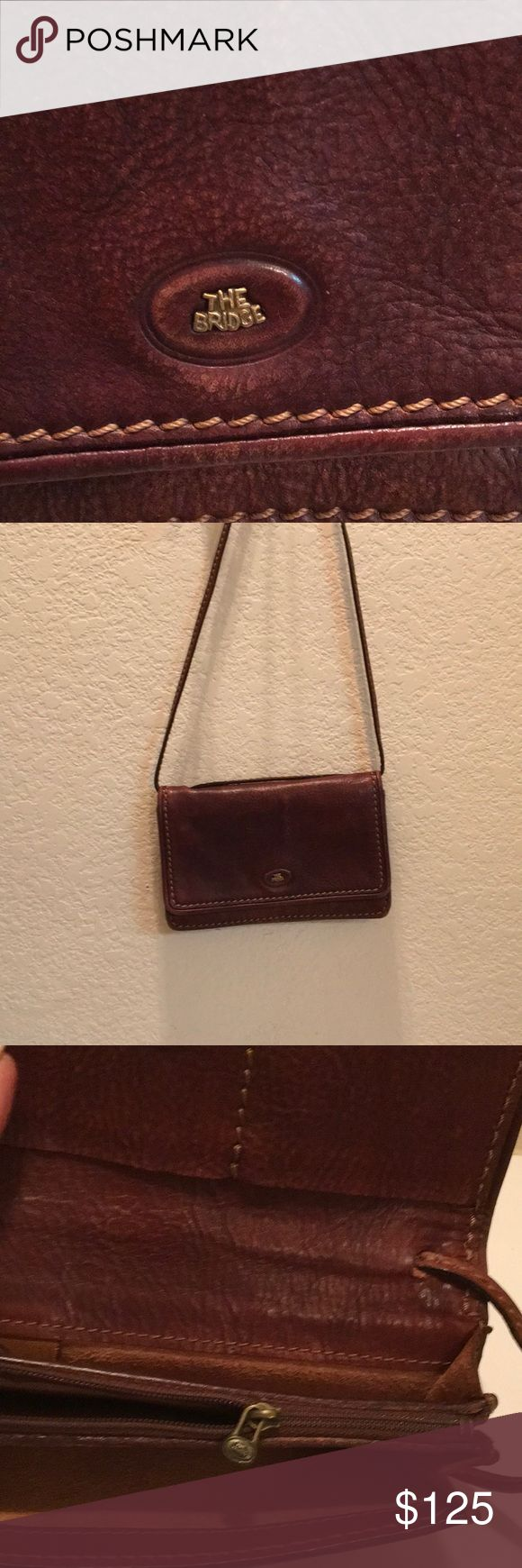 """THE BRIDGE cross body shoulder bag HOT in EUROPE I was told that European buy THE BRIDGE Bag the way AMERICAN women buy brands like BURBERRY, COACH, etc. They are sought after highly. ALL LEATHER lots of compartments zips snaps, slots. Adjustable 27 1/2"""" strap 4 1/2"""" x 7"""" x 1""""SUPER NICE THE BRIDGE Bags Crossbody Bags"""