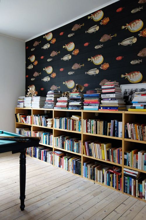 Low bookshelf with fun wallpaper create unity - home library design. Repin By @residencestyle