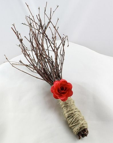 maybe something with sticks.. add some flowers or even broach flowers and maybe some feathers. =]