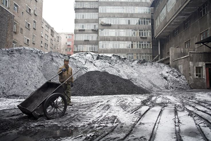 Carlos Spottorno. URÜMQI. Coal for household use in the countryard of an apartment building.