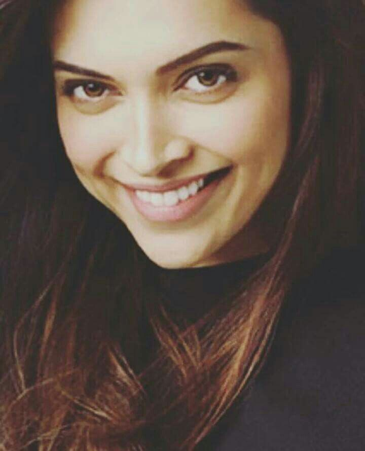 Deepika's smile keeps the day so calm and happy try it I dare you