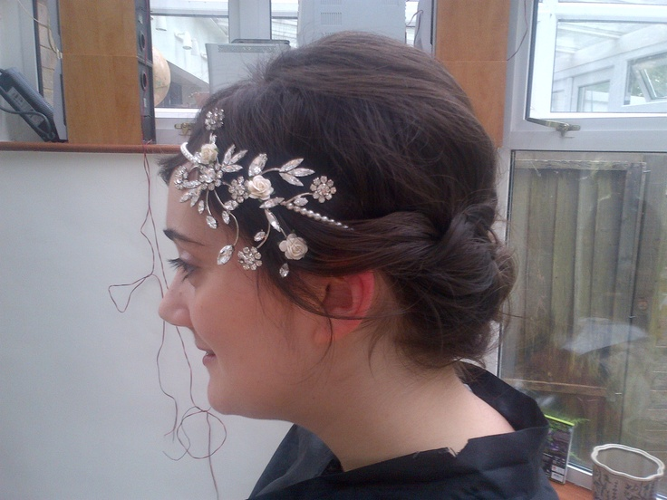 Bridal hair with hair piece.