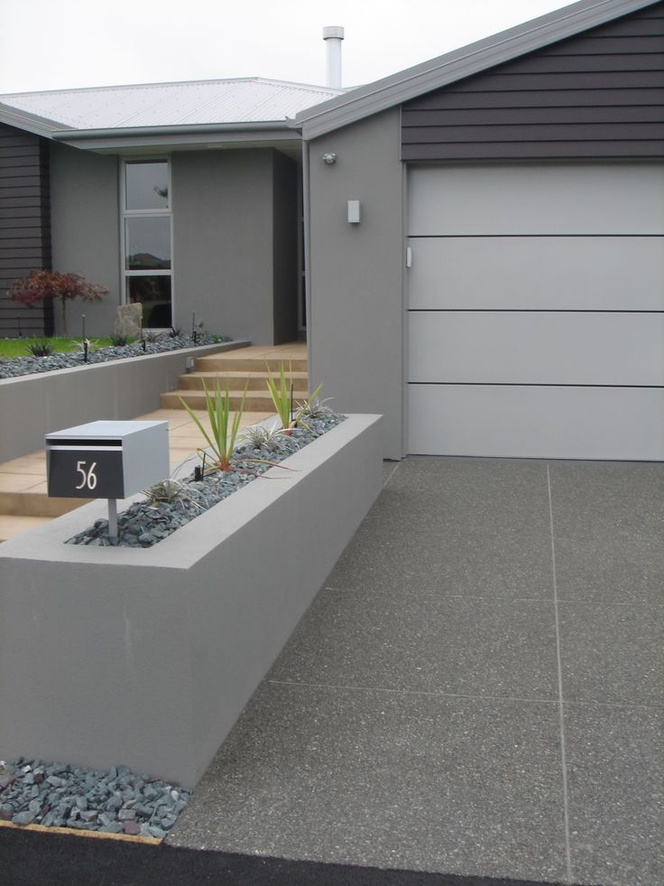 exposed coloured concrete driveway with trowel finished path beside more at wwwpeterfell