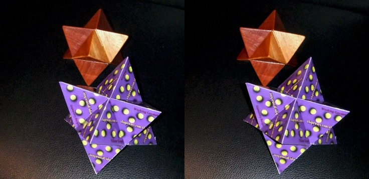 "A ""Double Planetoid"" puzzle made from folded business cards.                   http://on.fb.me/XajGjQ"