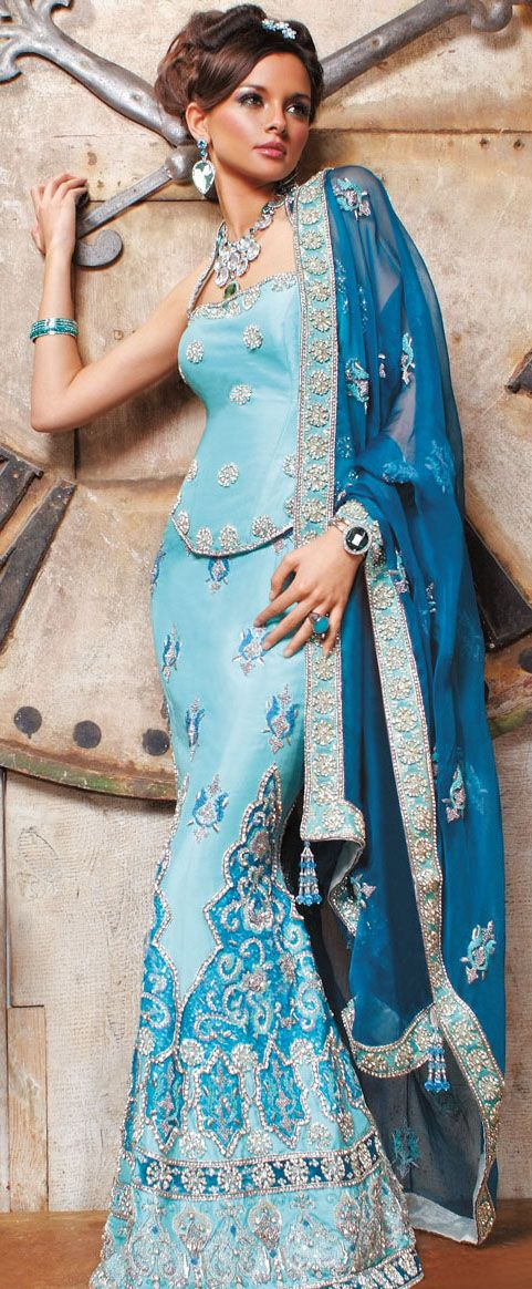 Raw silk and Velvet halter corset combined with aqua fishtail skirt with heavily embellished silver embroidery, crystals and sequins work. Outfit set with contrast royal blue dupatta.