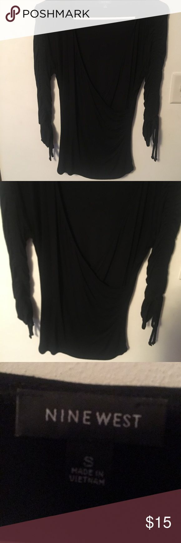Nine West shirt Size small Nine West long sleeve.  Sleeves don't come all the way down to wrist.  Sleeve also tie at the bottom.  Shirt looks like a wrap around but isn't. Nine West Tops Blouses