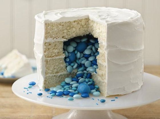 Gender Reveal Cake - Bake a cake filled with coordinated colored candies. #GenderReveal