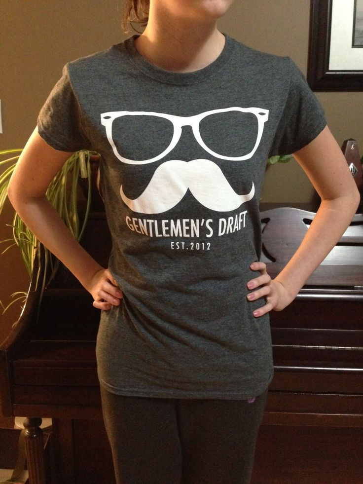 Ladies Cut t-shirt in Dark heather.  Check out Gentlemen's Draft Clothing at https://www.facebook.com/GentlemensDraft   $2 from each item sold is donated to prostate cancer research.  Join us in  helping to fight cancer, one shirt at a time.  Stay classy like never before with our signature moustache and glasses logo on our custom designed threads.  Also check us out on:  Instagram - gentlemens_draft