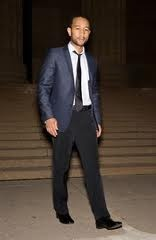 John Legend in a blue toned jacket and black pants suit | John