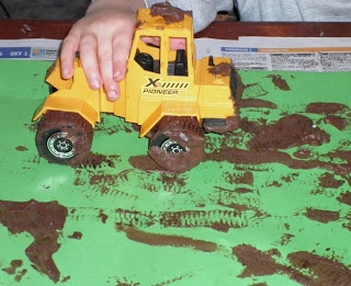 Art- tractor painting with mud paint.  Mix brown paint and shaving foam to make the mud paint