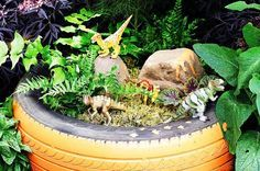 Dinosaur Garden kids play garden imagination dinosaur ideas create tire