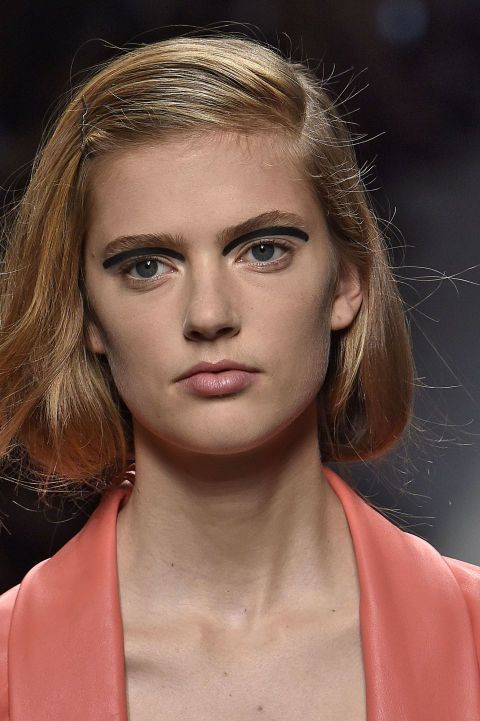 At Fendi in Milan, hairstylist Sam McKnight pinned the models' hair into faux bobs with deep side partings. Makeup was minimal save for bold floating eyeliner by makeup artist Peter Philips. Well, that's one way to achieve a wide-eyed look.