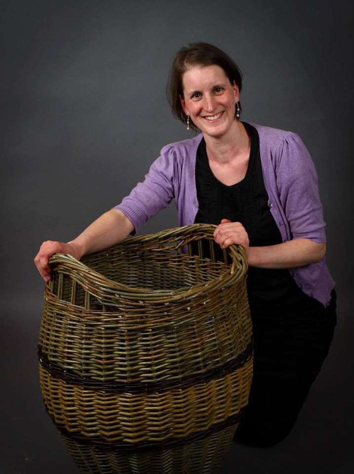 Large log basket made by Hanna Van Aelst barnabaunbasketry.ie