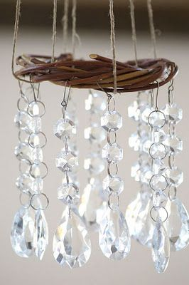 I'm thinking I can make these for my garden with some little dollar store grapevine wreaths, string, and a bag of inexpensive broken jewelry from the thrift store.