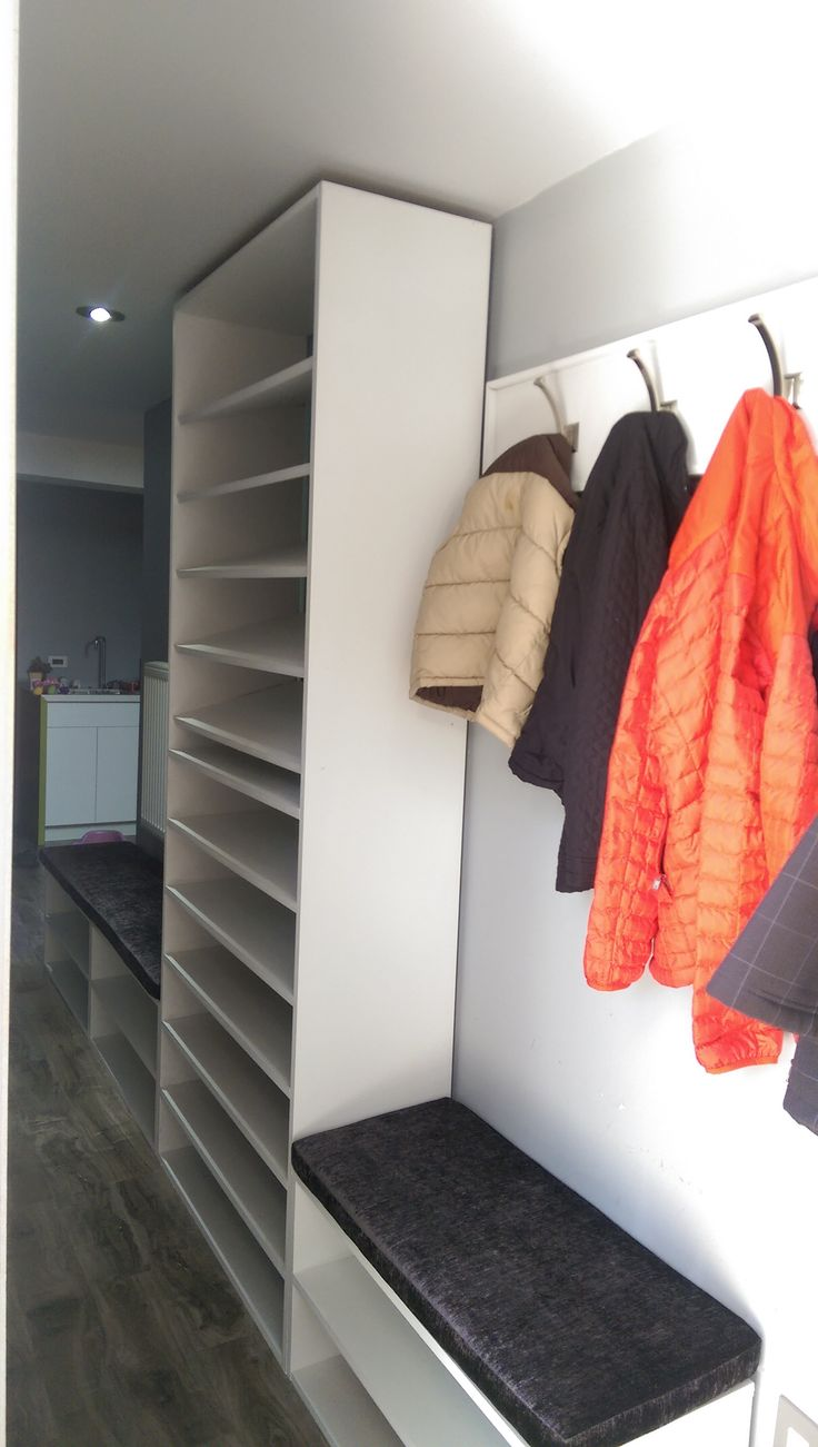 Custom bench, coat hangers and shoe storage  in an entry hallway