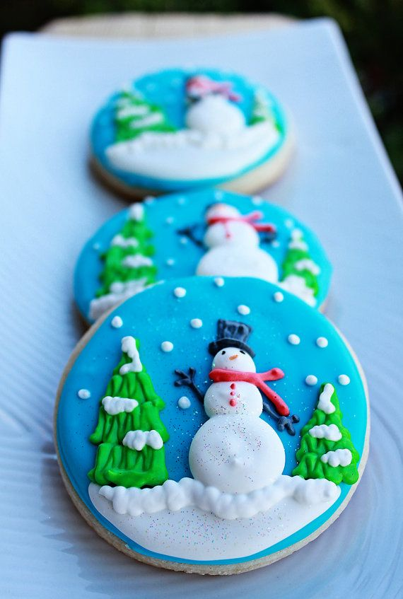 A beautiful collection of vanilla sugar cookie hand decorated intricately with a winterscape and dusted with edible glitter.    These cookies will be a wonderful addition to your holiday party or give a set of these unique cookies to friends and relatives.    This listing is for 6- 2