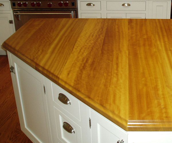 """1 1/2"""" thick Iroko premium wide plank island top. Natural color with Marine Oil Finish and an ogee-a edge."""