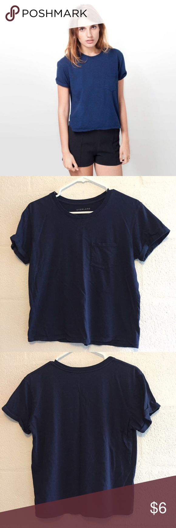 Everlane Box Cut Pocket Tee Sz S Everlane navy blue box cut pocket tee, size small. In good condition, but a little bit of fading. Super soft supima cotton, chest pocket, and sewn cuffed sleeves. Made in the USA. I love this but it doesn't suit my body type because it's a little bit cropped/boxy. First picture is a stock photo to show the fit. Everlane Tops Tees - Short Sleeve
