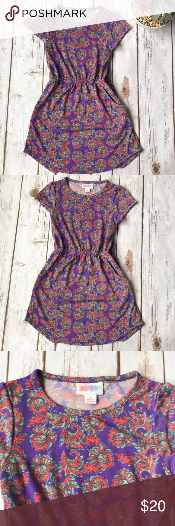 Toddler Girl LuLaRoe Mae Dress in Paisley Pattern EUC! Worn only once. This is a LuLaRoe Mae dress size 4 which fits size 3-4 per LuLaRoe size chart in the last pic. This costs $32 New and this is basically brand new. Super cute dress has pockets on both sides. Light and adorable for summer or spring. Smoke free home. LuLaRoe Dresses