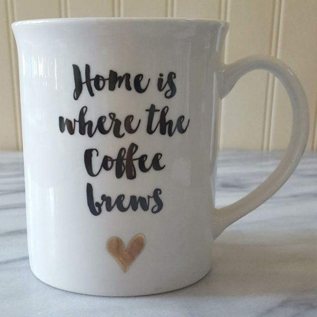 """""""HOME IS WHERE THE COFFEE BREWS"""" Coffee mug,WHITE MUG WITH LETTERING ON BOTH SIDES AND a CUTE gold HEART."""