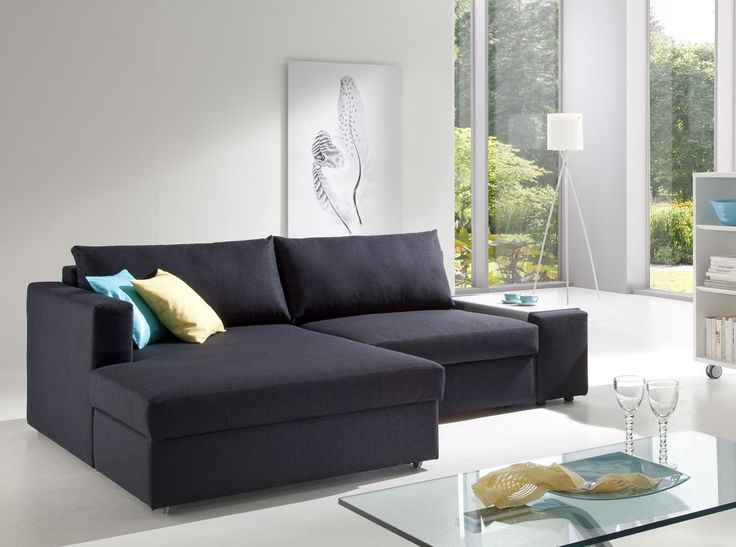 Corner sofas beds with glass table and glass window