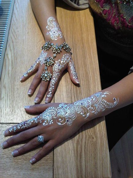 Silvery-white mehndi... totally intrigued.
