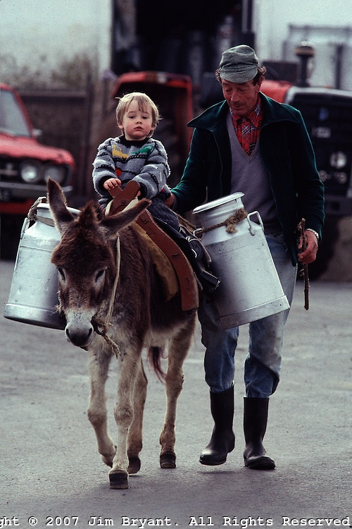 Terceira | Jim Bryant, #Portugal.......GRANDFATHER TAKES HIM ALONG WHEN HE DELIVERS THE MILK.......HE LOVES HELPING AND IT MAKES HIM FEEL SO GROWN UP........ccp