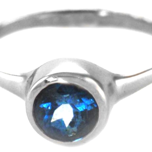 Sapphires.  My wedding ring.  I remember back shopping at vintage shops for estate jewelry.  That's what drew me to the blue stone.
