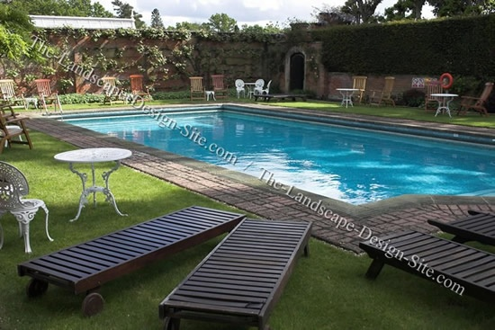 24 best images about landscaping around swimming pools on for Decor around swimming pool