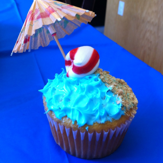 Beach themed birthday party for my nephews! We mad beach cupcakes! Blue frosting, mint candy as a beach ball, umbrella, and graham cracker crumbs as the sand!! Sooo cute! :0)