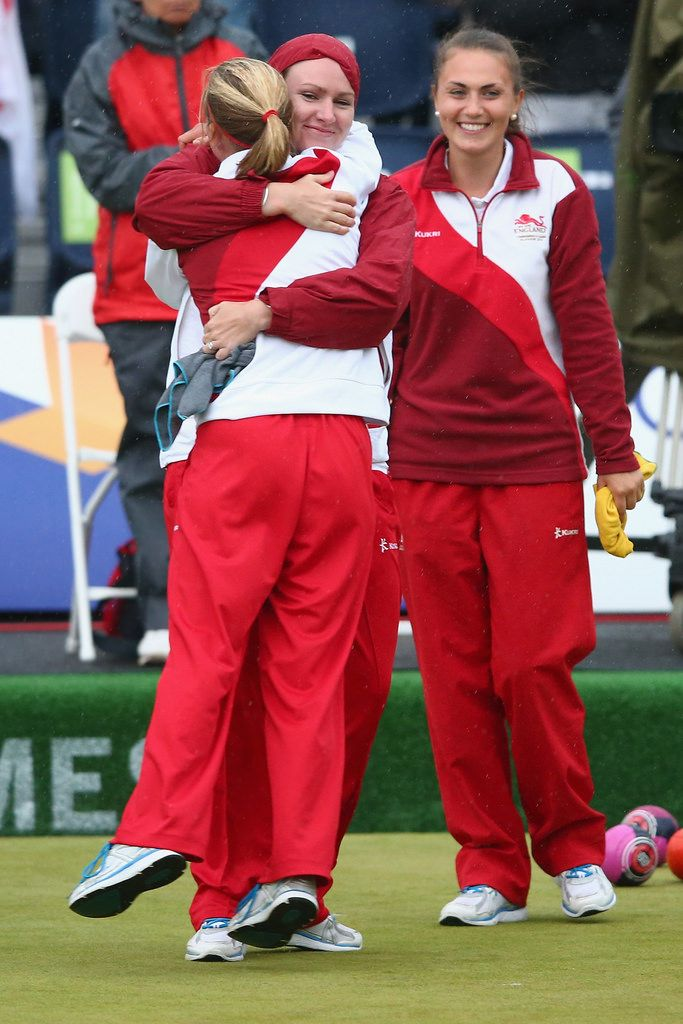 GLASGOW, SCOTLAND - JULY 31:  Ellen Falkner, Sian Gordon and Sophie Tolchard of England celebrate victory in women's triples final against Australia