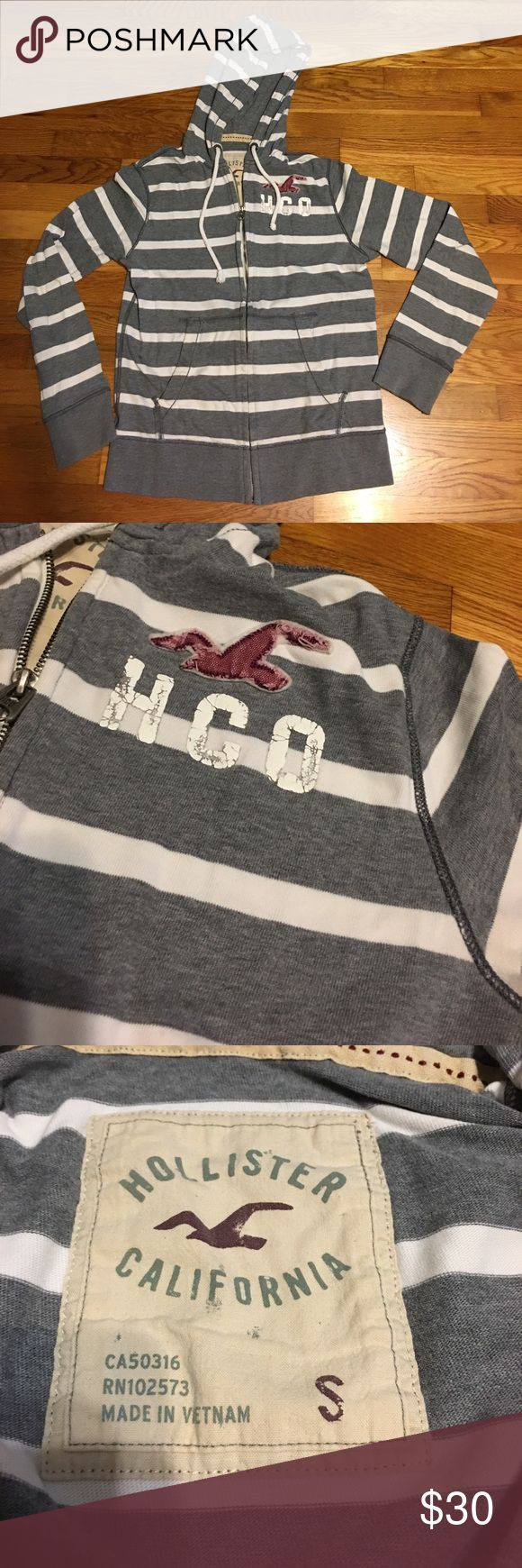 Stripe zip up hoodie sweatshirt Gray and white stripe Hollister men's hoodie size small ; but I've worn this sweatshirt and I'm a size M - had a nice comfortable fit - fit in all the right places Hollister Sweaters Zip Up