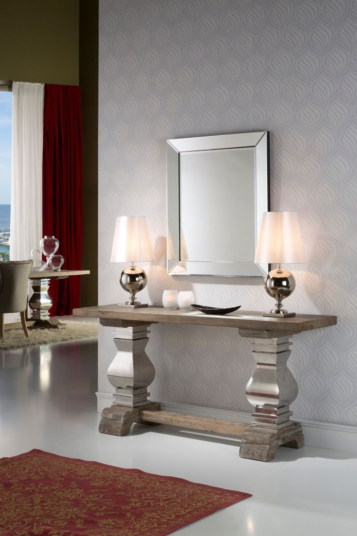 Designer wood and polished stainless steel console table. This antique style wood console is finished with white patina and boasts polished steel pilasters holding a 4.5 cm solid antique style wood top.