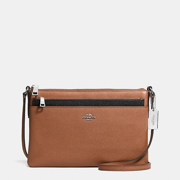 Coach  SWINGPACK WITH POP-UP POUCH IN EMBOSSED TEXTURED LEATHER Cute fall handbag option leaving you hands free for all of the fall activities you'll be doing. I want.
