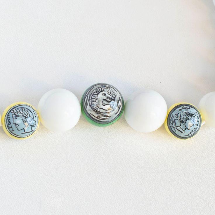 #Collana realizzata artigianalmente con pietre di Agata dipinte a mano. Gancio in argento. #Sicùlia Gioielli - made in Sicily - Visita il nostro shop http://www.bongiovannigioielli.com/collane/23-monete-di-sicilia.html