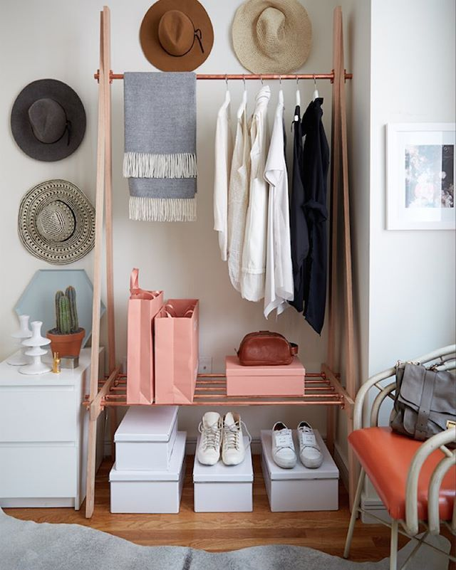 Hi! @lagracieuse here and today I'm taking over @onekingslane's instagram to share my bedroom makeover with #weekenddecorator @mepflug. The bedroom in my downtown Manhattan apartment is on the smaller side so we kept things neutral with accents of color. I'm obsessed with this oak and copper clothing rack she created for me - the warm copper tones will keep the space feeling cozy throughout the winter! Follow along today to see the rest of my space! #MyOKLStyle #okltakeover