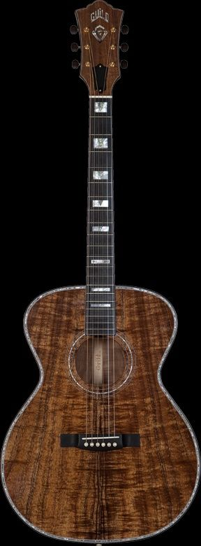 GUILD 60th Anniversary Custom Shop Orchestra | The Guild Custom Shop's first creation is the 60th Anniversary model—a limited-edition run of 60 finely appointed acoustic guitars designed in celebration of Guild's 2013 diamond anniversary. Based on the venerable Guild F-30 orchestra model, it has a beautiful 5A koa top, back and sides; red spruce bracing; an elegant mother-of-pearl rosette; abalone top purfling; rosewood body and neck binding; and a genuine diamond headstock inlay.