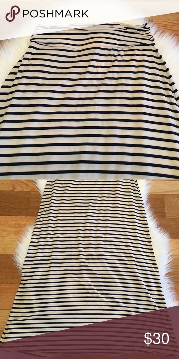 J. Crew Tan and Navy Striped Maxi Skirt J. Crew Tan and Navy Striped Maxi Skirt. Excellent used condition.  Approximate Measurements Size-XXS Waist-13 In. Length-40 In. J. Crew Skirts Maxi