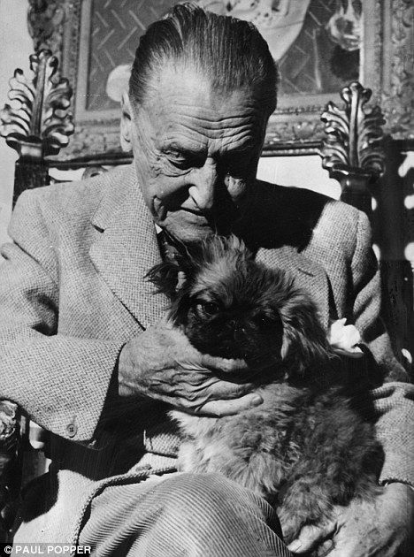 Somerset Maugham with his dog.. read his books !!! wondrous !!!