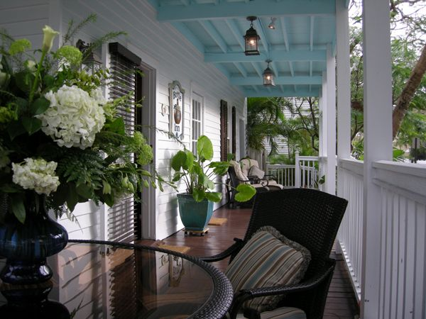 Key West style porch ~love the blue ceiling                                                                                                                                                      More