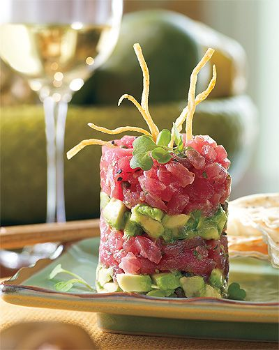 Loki-Loki Tuna Poke, Fresh Ahi tuna Napoleon layered with freshly made guacamole, soy, and sesame oil.