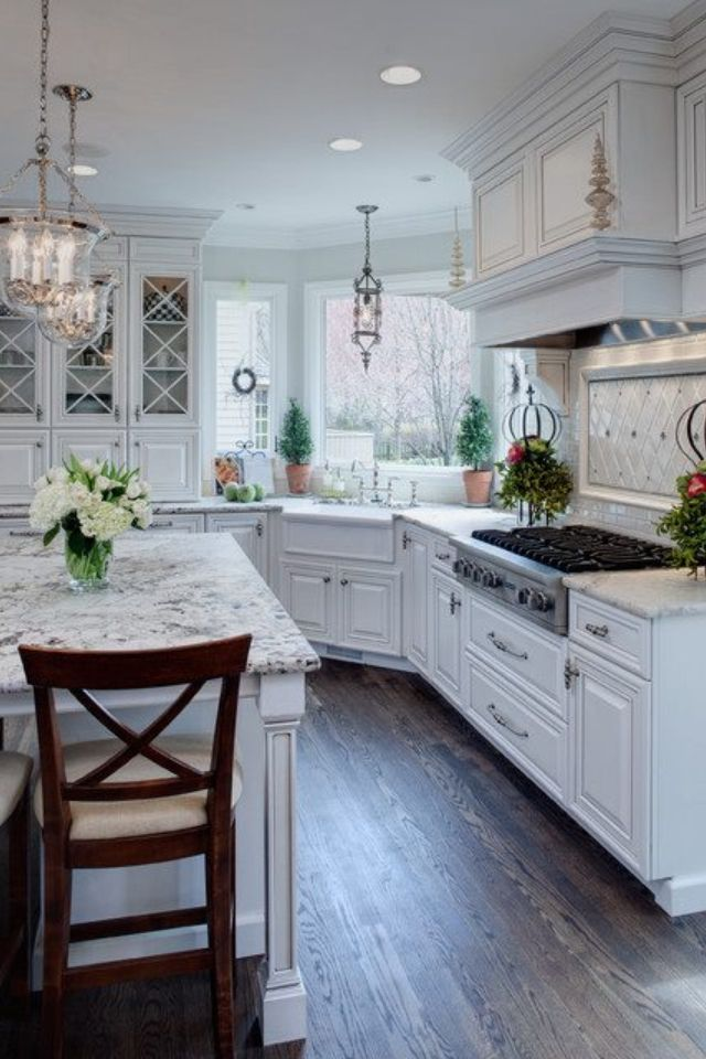 close to perfect - love how light it is...the crisscross details overlying the cabinetry, crown moulding, wood flooring.