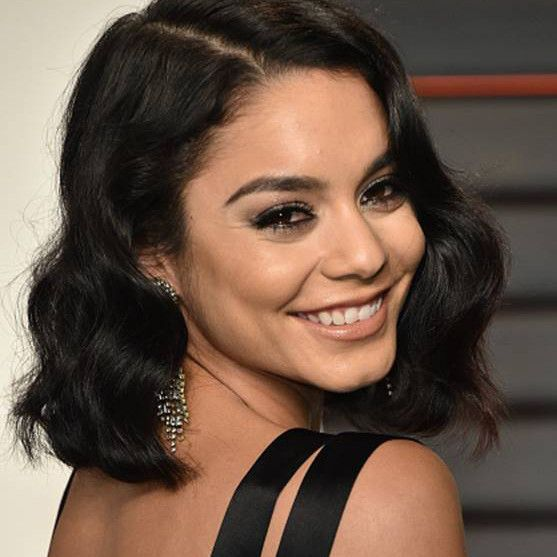 "Worn by Vanessa Hudgens at the Vanity Fair Oscars Party! The Chantilly Drop Earrings feature a lacy pattern of sparkling crystals - the ultimate chandeliers! Earrings are clip on and measure 4"". Materials: Oxidized & antique brass with crystals."