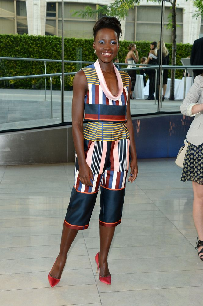 CFDA 2014 Red Carpet - Lupita Nyong'o in Suno. She is rockin' this modern, unconventional look - Love it.