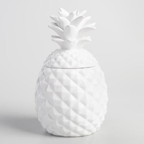 Crafted of ceramic with a classic white finish, our exclusive pineapple treat jar is a chic addition to the kitchen counter with an airtight lid that keeps your baked goods fresh.